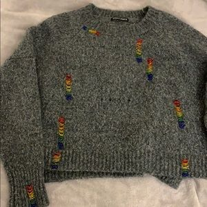 Unique rainbow-highlighted sweater